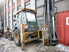Backhoe loader JOHN DEERE 325 K, 2012